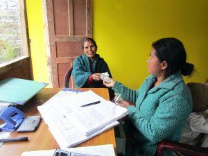 Aadiba cooperative member pays back her microloan, January 2020