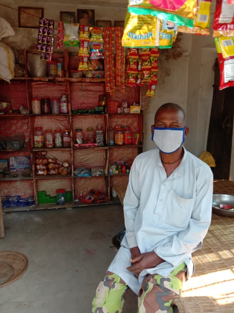 Shopkeeper wearing mask