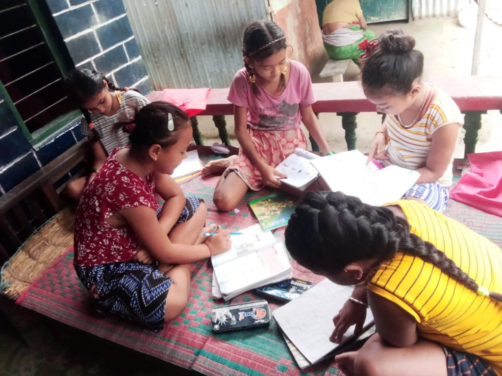 Students studying together at home